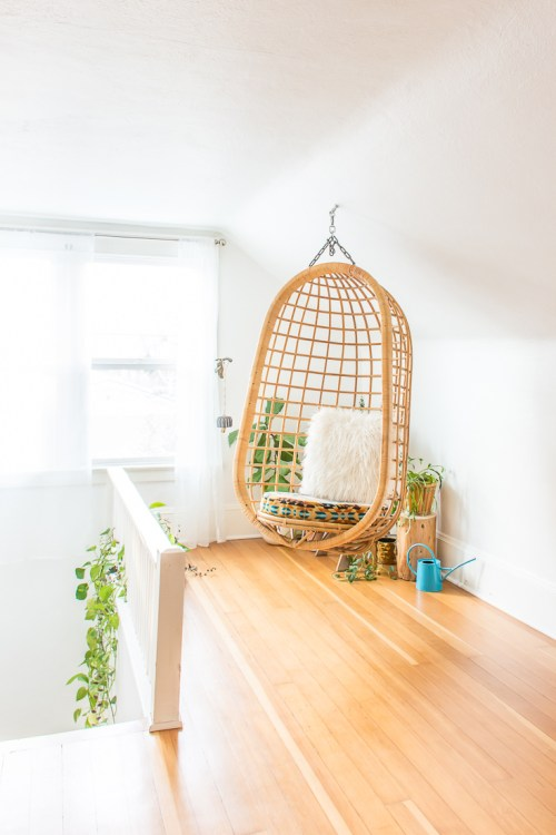 Lounge with hanging rattan chair and plants. #houseplants #plants