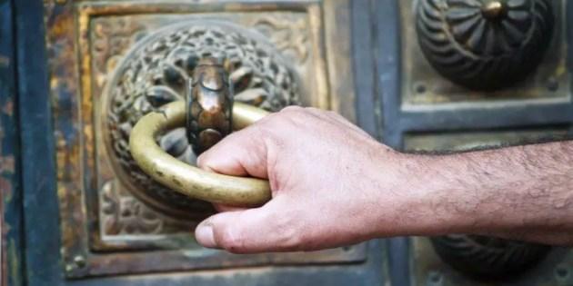 Door knocker with man's hand.