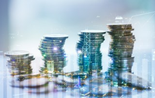 Double exposure of city with graph and stack of coins for finance and business concept