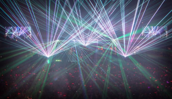 Arena Scene: Lasers fire over festival fans. Criss Images