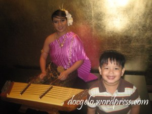 the beautiful lady dressed in thai was playing the string instrument, KHIM