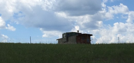 Old boxcar against a western sky.