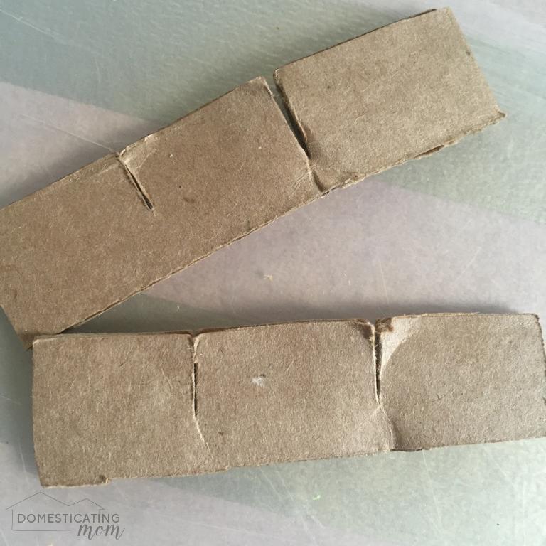 Slits in strips of cardboard