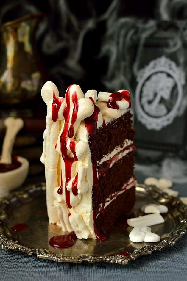 Spooky meringue bone palace Halloween cake - chocolate cake, vanilla swiss meringue buttercream, raspberry jam, meringue bones and berry coulis 'blood'