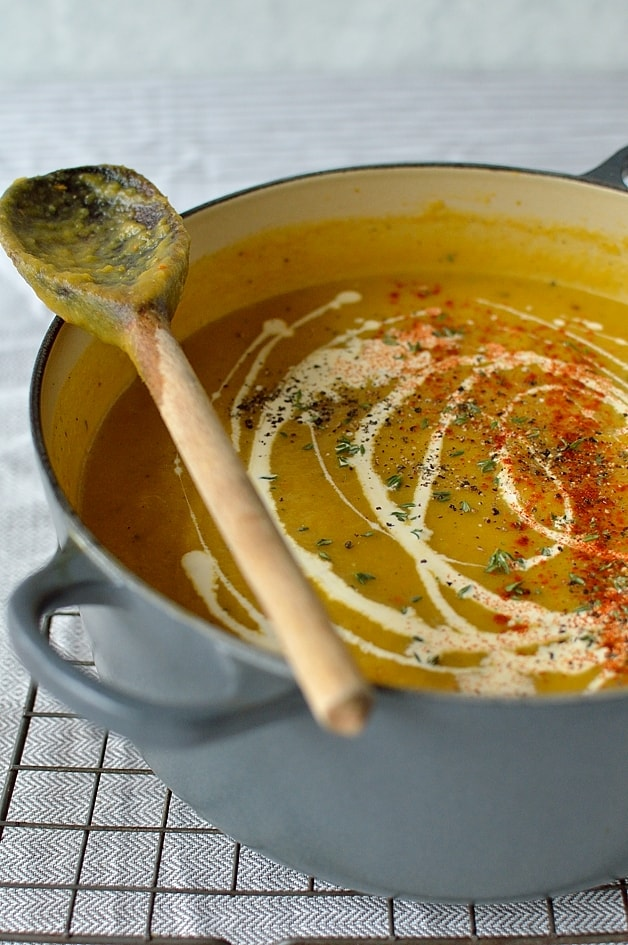 Easy spiced roasted pumpkin soup with homemade croutons, feta cheese and herbs