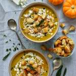 Warmly spiced roasted pumpkin soup with garlicky croutons, feta cheese and fried sage