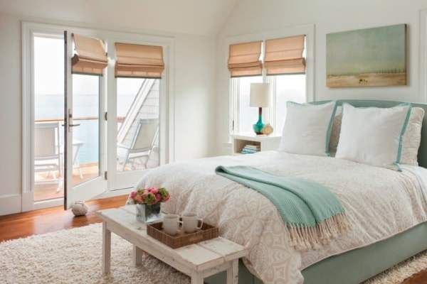 Blue-And-Green-beach-side-Beachside-Bedroom-beige-shades-blue-blue-bedframe-blue-fabric-bed-breezy-coastal-decor-coastal-home-cream-deck-ethereal-fresh-glazed-ceramic-lamp-hard-wood-hardwood-li