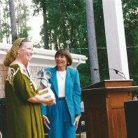 Sec. of State Sandra Mortham presenting Gamble's wife Nancy with the Artist Hall of Fame Award