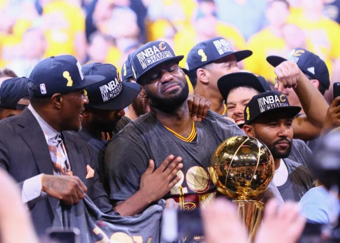 541547458-lebron-james-of-the-cleveland-cavaliers-holds-the-larry.jpg.CROP.promo-xlarge2[1]