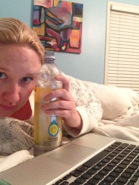 Feeling blah in bed with my water, which I promptly spilled all over myself after taking this photo.