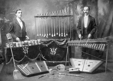 Two hammered dulcimer players and percussionists playing a variety of instruments