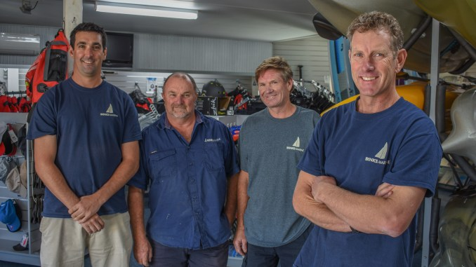 Sandy Higgins (right) with his team at Binks Marine.