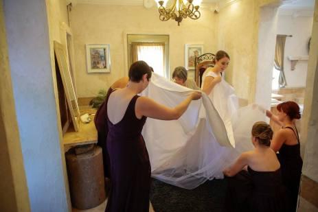 The fluffing of the skirt, a full team endeavor.