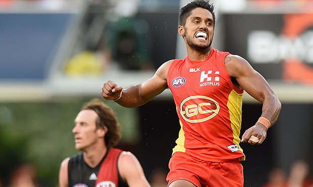 GOLD COAST, AUSTRALIA - MARCH 26: Aaron Hall of the Suns celebrates kicking a goal during the 2016 AFL Round 01 match between the Gold Coast Suns and the Essendon Bombers at Metricon Stadium, Gold Coast on March 26, 2016. (Photo by Matt Roberts/AFL Media)