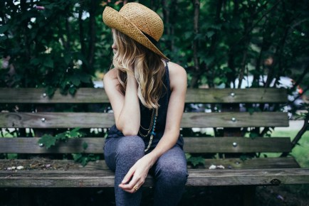 blond straw hat bench