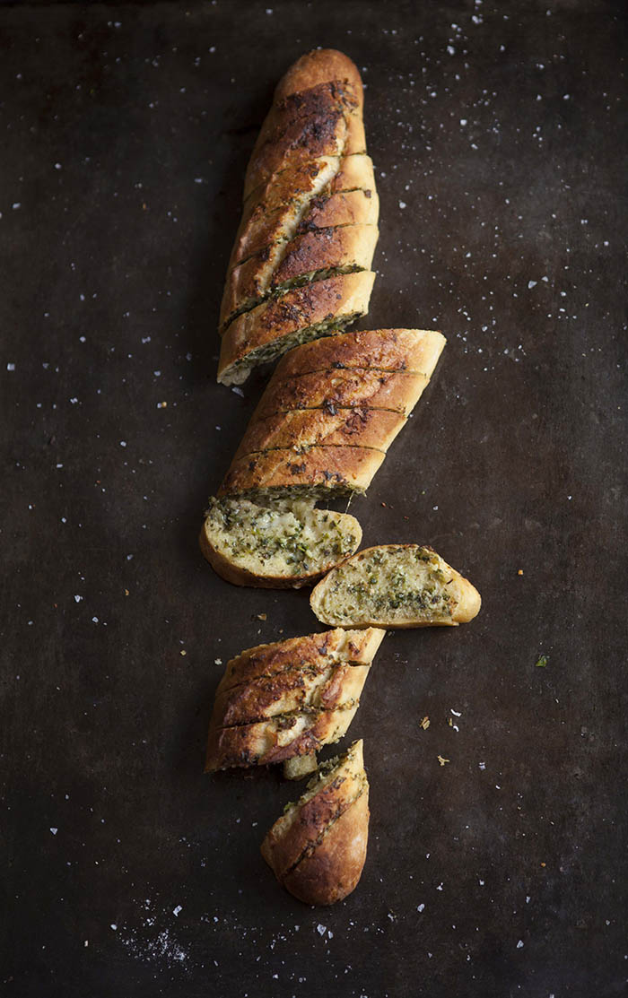 garlic bread with salsa verde and parmesan cheese