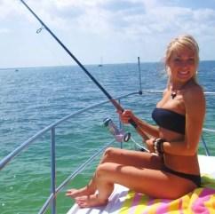 Fishing babe on boat