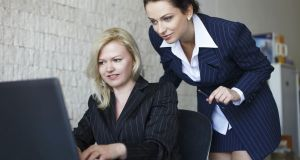 Confident businesswomen team communicate by laptop in office