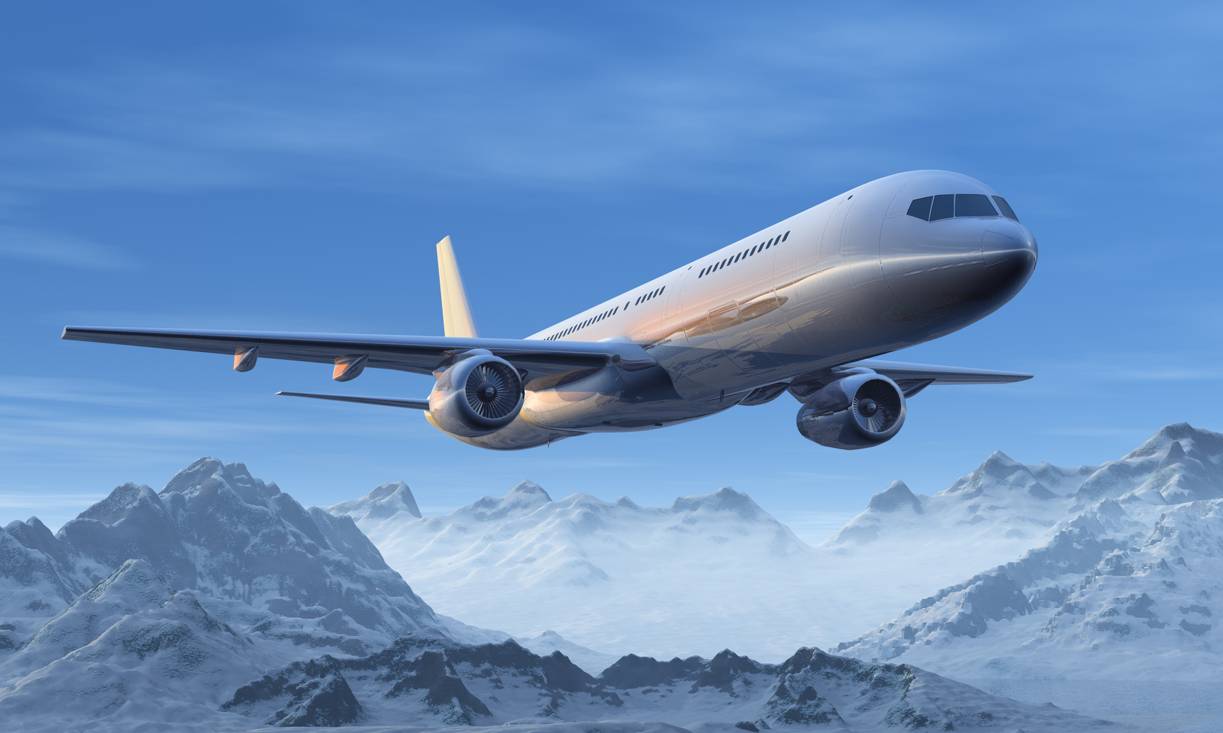 Scenic morning airliner flight over the snowy mountain peaks