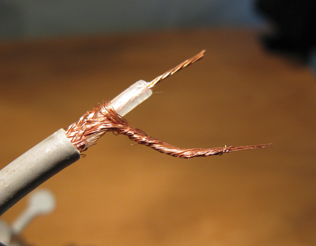 Fig. 3. Preparing a shielded cable for soldering. I've twisted the outer wire shielding together and exposed the conductor wire in the center.