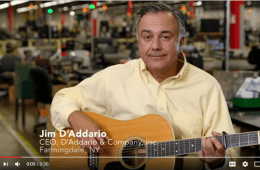 jim d'addario with a guitar, the ceo of d'addario
