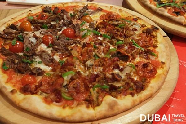 meat pizza itzza pizza dubai