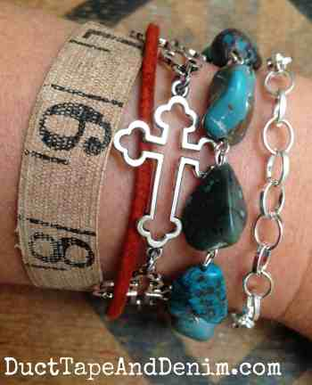 Arm party with sideways silver cross bracelet and turquoise beads | DuctTapeAndDenim.com