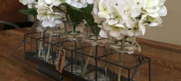 Bottle carrier flower vase centerpiece from T J Maxx. | DuctTapeAndDenim.com