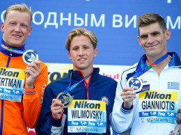 Second placed Weertman of the Netherlands, first placed Wilimovsky of the U.S. and third placed Gianniotis of Greece pose with medals after the open water men's 10km at the Aquatics World Championships in Kazan