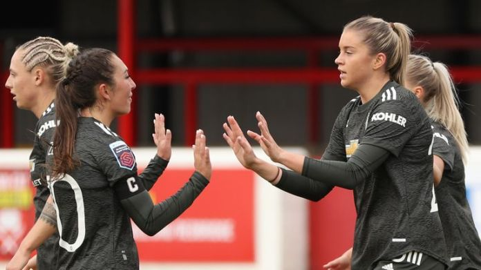 Manchester United Women players Katie Zelem (l) and Alessia Russo