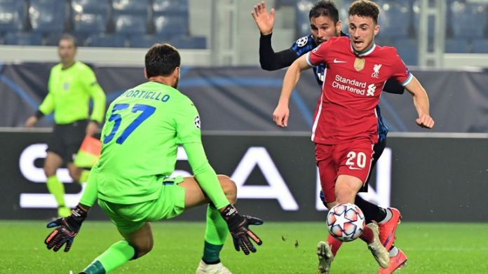 Diogo Jota chips over Atalanta goalkeeper Marco Sportiello to give Liverpool the lead in Italy