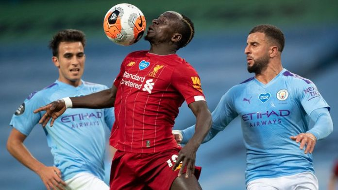 Sadio Mane of Liverpool in action with Kyle Walker and Eric Garcia of Manchester City IMAGE PANEL