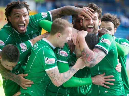 Celtic's Tom Rogic can't be seen as his team-mates celebrate