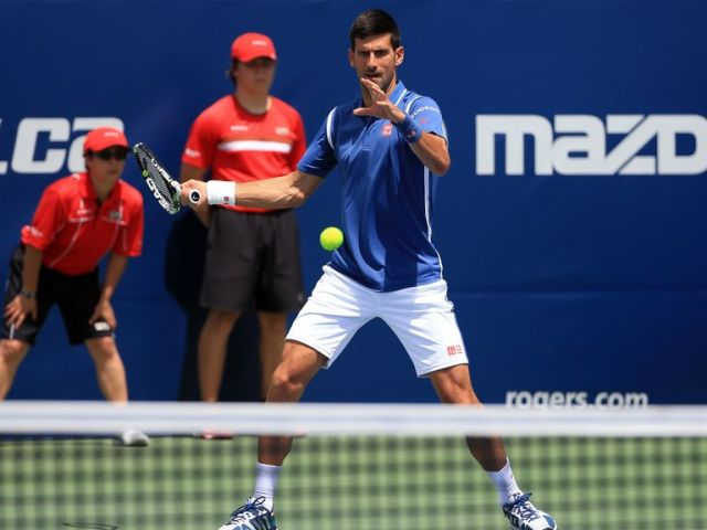 Novak Djokovic won his opening singles match in Canada