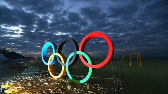 The Olympic Rings are displayed at the Copacabana beach