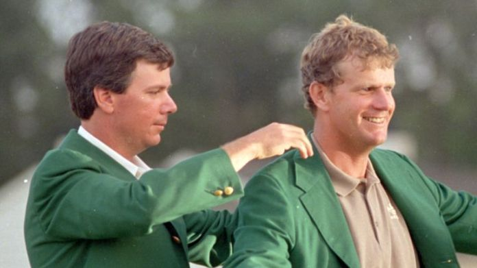 Sandy Lyle was presented with the Green Jacket by Larry Mize