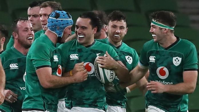 Ireland's wing James Lowe (C) celebrates with team-mates after scoring a late try against Wales