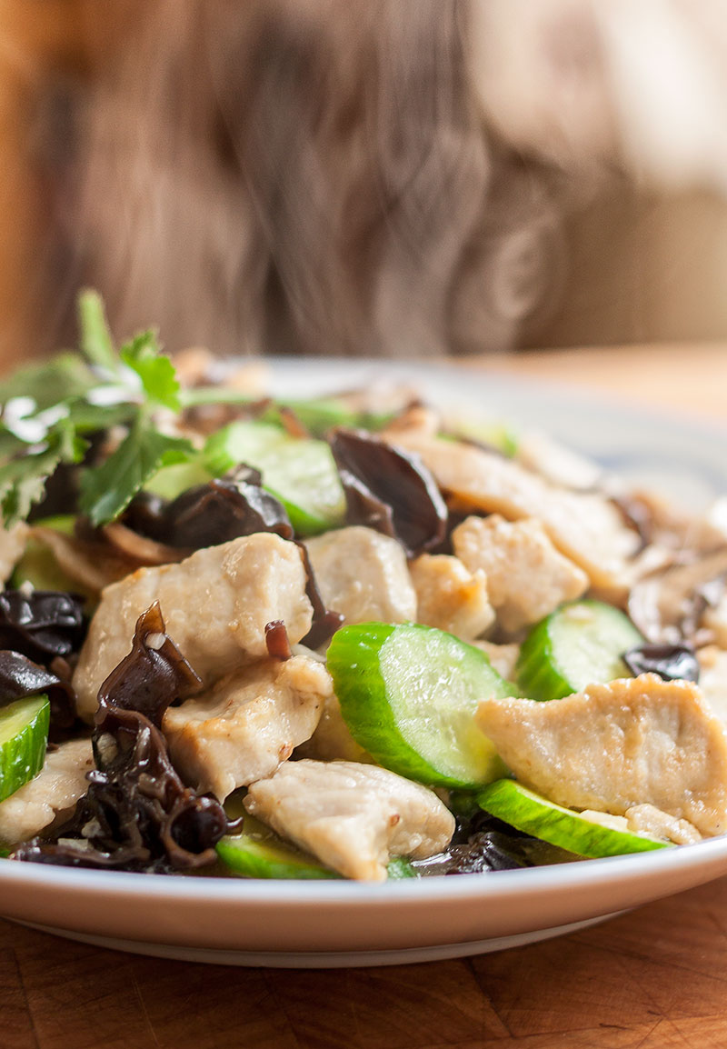 Stir-Fried Pork with Cucumber and Asian Mushrooms on a big plate