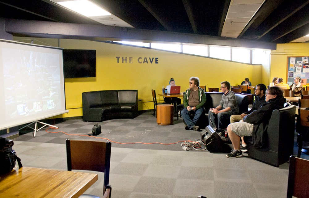 The Video Game Day hosted in the D.P. Culp University Center Cave offered students a day to relax and relieve stress by playing video games projected onto three large screens that were set up for the students to use. (Photograph by Kathleen Knowling/East Tennessean)