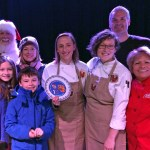 Winners of The Spectacular Cookie Smackdown, Ellie's Bakery. Holding trophy is Danielle Lowe, to her left is owner Ellen Slattery with her two children (and Santa!) to the right are Pastry Chef Melissa Denmark and judges Chefs Andrew Shotts and Maria Meza