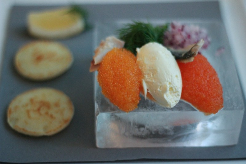 Bleak roe, creme fraiche and white fish roe with blinis at ICEHOTEL restaurant