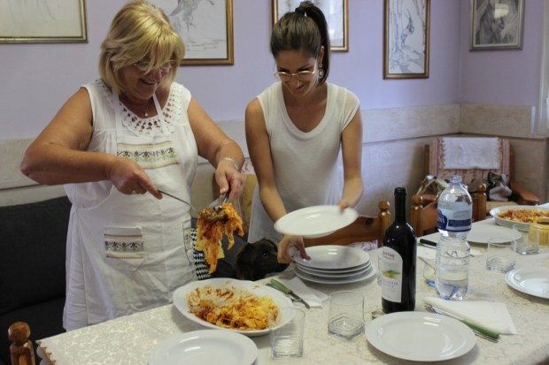 Serving up the ragu! Anna, on the left.