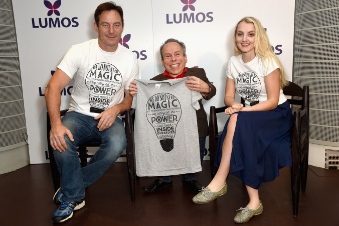 LONDON, ENGLAND - SEPTEMBER 18: Jason Isaacs,Warwick Davis and Evanna Lynch supporting the Lumos launch of its 'Be the Light' T-shirt to raise funds for its work to help end the institutionalization of children around the world at The Hospital Club on September 18, 2016 in London, England. (Photo by David M. Benett/Getty Images for Lumos)