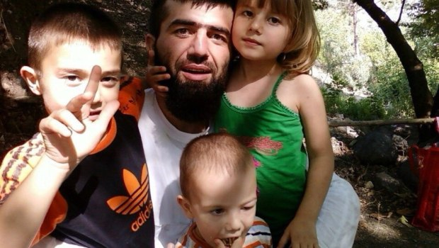 Ruslan with his family before he became Sayfullakh