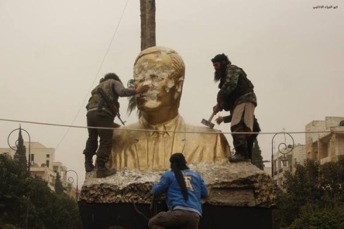 REBELS ASSAD STATUE IDLIB