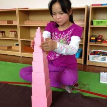 Li-showing-tower-she-built