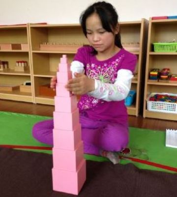 Li-showing-tower-she-built