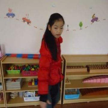Lin-listening-to-a-teacher