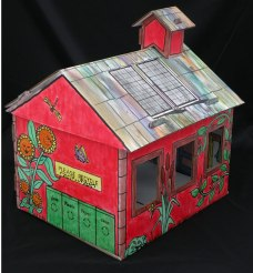 green toy schoolhouse