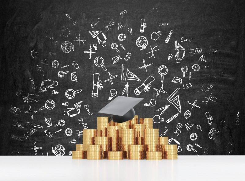 Graduation hat is laying on the coins pyramid. A concept of a high price for the university education. Education icons background.